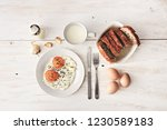 top view of sunny side up... | Shutterstock . vector #1230589183