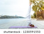 standing on the head. young...   Shutterstock . vector #1230591553