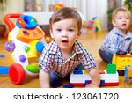 curious baby boy studying... | Shutterstock . vector #123061720