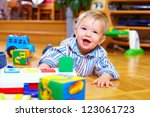 cute baby boy playing with toys ... | Shutterstock . vector #123061723