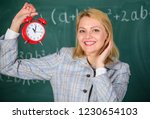 girl school lecturer. what time ...   Shutterstock . vector #1230654103