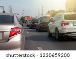 cars on the road heading... | Shutterstock . vector #1230659200