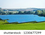 sun battery panel farm in the... | Shutterstock . vector #1230677299