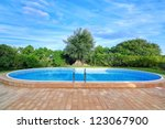 lovely pool in the garden in... | Shutterstock . vector #123067900