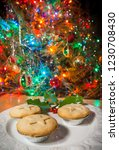 a plate of mince pies under a... | Shutterstock . vector #1230708430