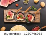 raclette cheese with salami | Shutterstock . vector #1230746086