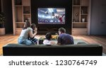 a family is watching a soccer...   Shutterstock . vector #1230764749
