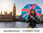 beautiful traveler woman with... | Shutterstock . vector #1230857530
