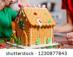 family decorates gingerbread... | Shutterstock . vector #1230877843