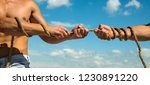 pulling hard. tug war is a...   Shutterstock . vector #1230891220
