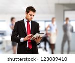 businessman using his tablet in ... | Shutterstock . vector #123089410