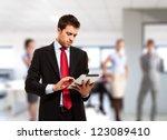 businessman using his tablet in ... | Shutterstock . vector #123089410
