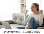 excited young female sit on... | Shutterstock . vector #1230899509