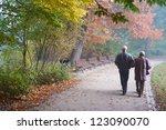 Senior Couple Walking  In The...