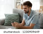 happy man relax on couch at... | Shutterstock . vector #1230909649