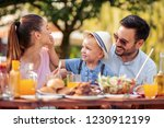 young family having lunch in... | Shutterstock . vector #1230912199