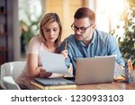 portrait of young couple... | Shutterstock . vector #1230933103