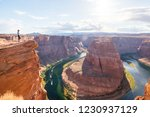 Woman Stands Over The Edge Of...