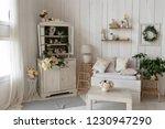 sofa stands in the interior... | Shutterstock . vector #1230947290