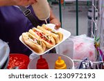sale of bread with hot dogs in... | Shutterstock . vector #1230972193