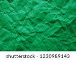 a piece of green wrinkled paper ... | Shutterstock . vector #1230989143