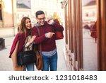 beautiful young couple enjoying ... | Shutterstock . vector #1231018483