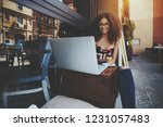 young businesswoman with curly... | Shutterstock . vector #1231057483