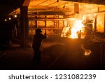 steelworker when pouring liquid ... | Shutterstock . vector #1231082239