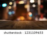 empty dark wooden table in... | Shutterstock . vector #1231109653