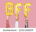hands holding bff word in... | Shutterstock . vector #1231136029