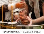 newborn baby baptism in holy... | Shutterstock . vector #1231164460