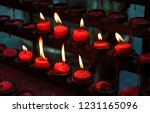 red candles with yellow flame...   Shutterstock . vector #1231165096
