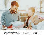 father congratulates his little ...   Shutterstock . vector #1231188013