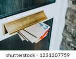 post in the door mailbox | Shutterstock . vector #1231207759