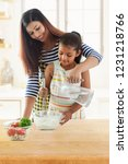 mother and daughter kneading... | Shutterstock . vector #1231218766