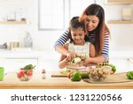 mother teaching daughter how to ... | Shutterstock . vector #1231220566