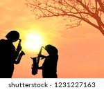 Silhouette 2 Musicians With...