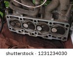 disassembled the cylinder head... | Shutterstock . vector #1231234030