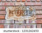 old rusty home label on brick... | Shutterstock . vector #1231262653