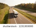 highway. trucks while driving ... | Shutterstock . vector #1231303000