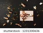 gift box with golden bow on... | Shutterstock . vector #1231330636