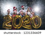 happy friends holding 2020... | Shutterstock . vector #1231336609