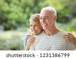smiling senior couple embracing ...   Shutterstock . vector #1231386799