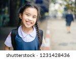 back to school. happy smiling... | Shutterstock . vector #1231428436