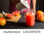 freshly squeezed grapefruit... | Shutterstock . vector #1231455373