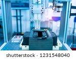 robot holding glue syringe... | Shutterstock . vector #1231548040