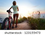 Young Woman With Bicycle...