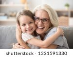 happy old grandmother hugging... | Shutterstock . vector #1231591330