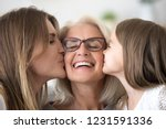 grown daughter and child... | Shutterstock . vector #1231591336