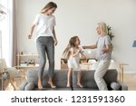 happy kid granddaughter  mother ... | Shutterstock . vector #1231591360